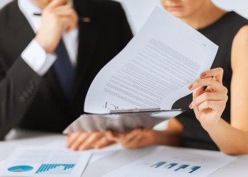 business, office, law and legal concept - picture of man and woman hand signing contract paper